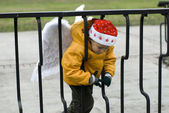 Little boy angel in Christmas hat outdoors — Stock Photo
