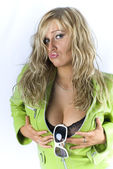 Blondie in green jacket posing in studio and holding her breast — Stock Photo