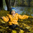 Boy relaxing in autumn — Stock Photo