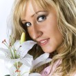 Blonde with madonna lily — Stock Photo #15411007