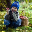 Boy with apples - Stock Photo