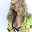 Blondie in green jacket posing in studio and holding her breast — Stock Photo #15425771