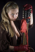 Beautiful blond girl with guitar — Stock Photo