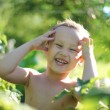 Smiling happy boy outdoors, soft focus glass — Stock Photo #15828427