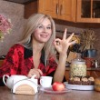 Woman sniffing the scent cup of hot drink, breakfast in the kitc - Stock Photo