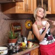 Attractive young woman standing in the kitchen — Stock Photo