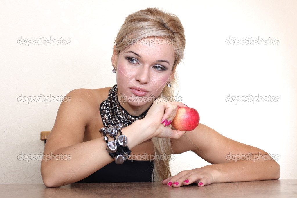 Woman with red apple — Stock Photo #15828099
