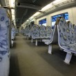 Contemporary train interior. Empty seats. — Stock Photo #16044911
