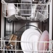 Dishes out of dishwasher close-up - Stock Photo