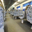 Contemporary train interior. Empty seats. — Stock Photo