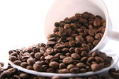 Cup and Background coffee beans. — Stock Photo