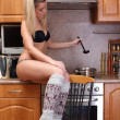 Stock Photo: Funny woman cooking dinner