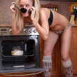 Funny woman cooking dinner — Stock Photo