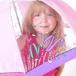 Small girl under umbrella - Stock Photo