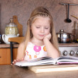 Little girl with books — Stock Photo