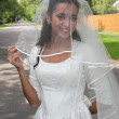 Bride on a road — Stock Photo