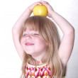 Small girl with apple — Stock Photo