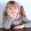 Little girl with blue eyes  at wall in room — Stock Photo