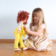 Little girl with doll in room — Stock Photo