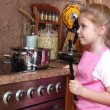 Little girl cooking in the kitchen — Stock Photo