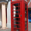 Traditional red telephone box in London, UK — Стоковая фотография