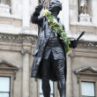 Statue of Sir Joshua Reynolds in the atrium of the Royal Academy of Arts. - Stock Photo