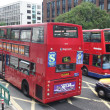 Red bus in the street of London - Stock Photo