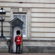 Guard in traditional red uniform, London, England - Stock Photo