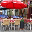 Empty classic european street cafe — Stock Photo