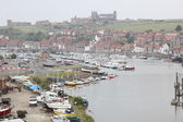Scenic view of Whitby town with boats on Esk river, North Yorkshire, England — Stock Photo