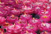 Wish pink candles during offering in a Chinese temple — Stock Photo