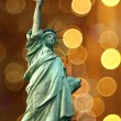 NY Statue of Liberty against holidays flash circle — Stockfoto
