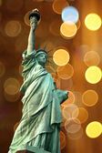 NY Statue of Liberty against holidays flash circle — Stock Photo