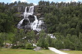 Tvindefossen Waterfall in summer sunny day, Norway — Stock Photo