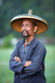 GUANGXI - JUNE 18: Chinese man in old hat in Guangxi region, tra — Stock Photo