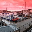 Stock Photo: Fishing boat at quayside in the harbour