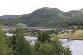 Long modern bridge over fiord in norway — Stock Photo
