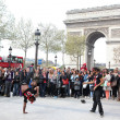 PARIS - APRIL 27:: B-boy doing some breakdance moves in front  a street crowd — Stock Photo