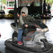 Stock Photo: Boy driving bumper car