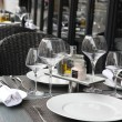 Street view of a Cafe terrace with empty tables and chairs,paris France — Stock Photo