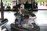 Boy driving a bumper car — Stock Photo
