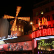 Stock Photo: PARIS - MAY 3: Moulin Rouge at night, on May 3, 2013 in Pari