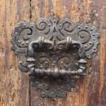 Old metal door handle on very old wooden door — Stock Photo #27278365