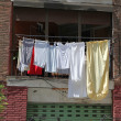 Laundry drying on Barcelona house — Stock Photo