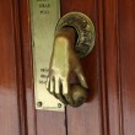 Door handle in shape of human hand, Barcelona — Stock Photo #27278533