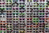 Plastic sunglasses on display — Stock fotografie