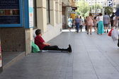 Begger ath the street of Madrid — Photo