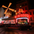 PARIS - MAY 3: The Moulin Rouge at night, on May 3, 2013 in Paris, France — Stock Photo #28715745