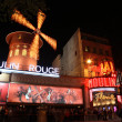 Stock Photo: PARIS - MAY 3: Moulin Rouge at night, on May 3, 2013 in Paris, France