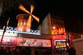 PARIS - MAY 3: The Moulin Rouge at night, on May 3, 2013 in Paris, France — Stock Photo